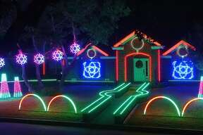 """Johnson Family's home is decked with more than 7,000 programmed lights, and was even featured on the ABC TV show """"Christmas Light Fight.""""."""