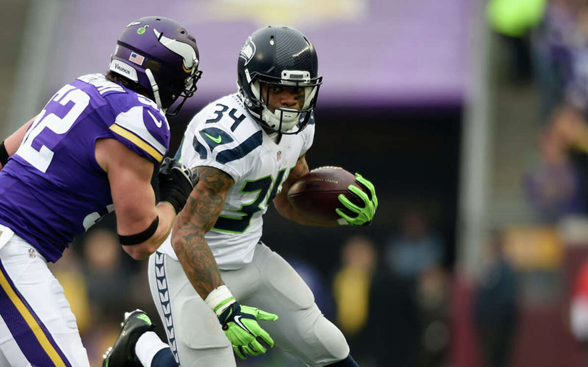 Running backs: Undrafted rookie Thomas Rawls continued to impress, racking up 101 yards and a touchdown on 19 carries. Rawls has proved a more than competent replacement for running back Marshawn Lynch. On Sunday, Rawls fumbled on the Seahawks' first possession, his first of the season, but he responded with another steady performance. Also, veteran Fred Jackson reminded 12's that he's still on the team by catching two passes for 13 yards and a touchdown. He also had one rush for five yards. But you have to dock the final grade slightly for Rawls' fumble. Grade: A-