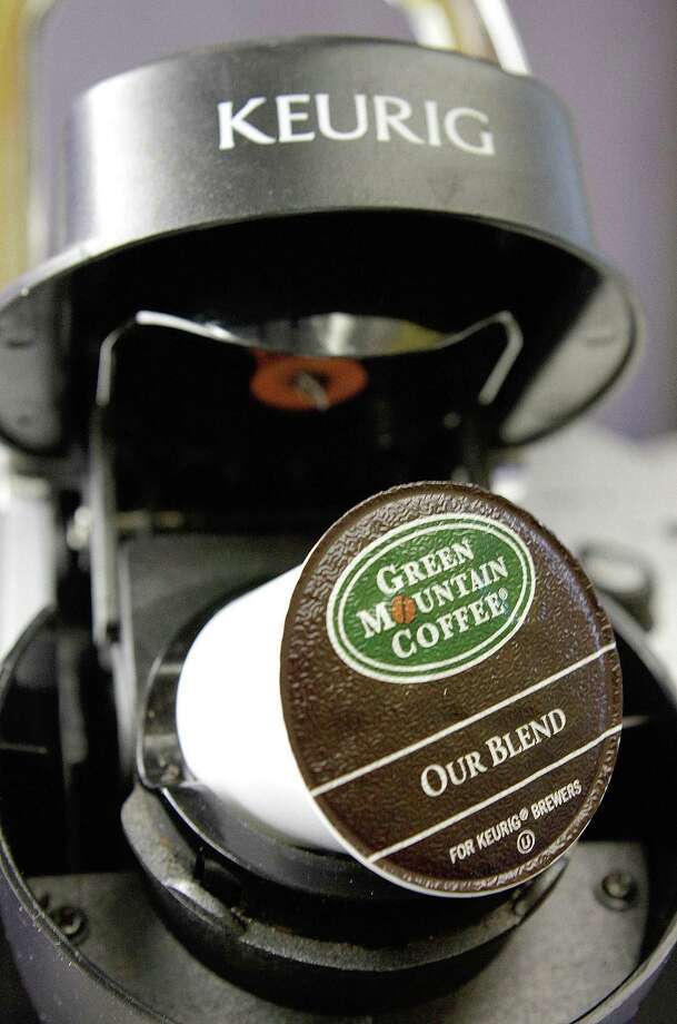 FILE - In this Oct. 7, 2010, file photo, a Green Mountain Coffee single-serving brewing cup is seen in a Keurig machine in Montpelier, Vt. Keurig, the single-cup coffee machine maker, said Monday, Dec. 7, 2015, that it has agreed to be sold to private equity firm JAB Holding Co. for almost $14 billion. (AP Photo/Toby Talbot, File) ORG XMIT: NYBZ128 Photo: Toby Talbot / AP