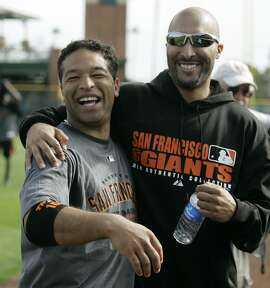 San Francisco Giants left fielder Dave Roberts, left, and right fielder Randy Winn, right, embrace each other during their spring training baseball workout in Scottsdale, Ariz., Tuesday, Feb. 19, 2008. (AP Photo/Eric Risberg)