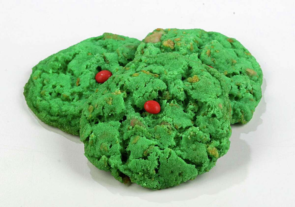 """Grinch Hearts Chewy, festive cookies made with cornflakes for crunch and topped with a tiny """"heart"""" sprinkle. Kids will love them. Get the recipe on HoustonChronicle.com."""