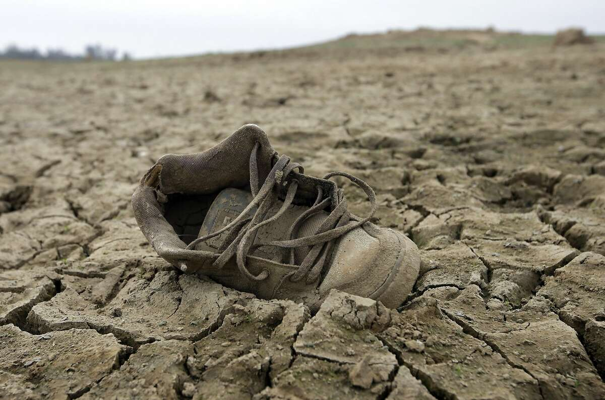 In this photo taken Tuesday Oct. 27, 2015, a shoe sits on the dry lake bed at Folsom Lake, in Folsom, Calif. The State Water Resources Control Board is expected to release statewide water conservation figures for October at a water board meeting Tuesday, Dec. 1. (AP Photo/Rich Pedroncelli)