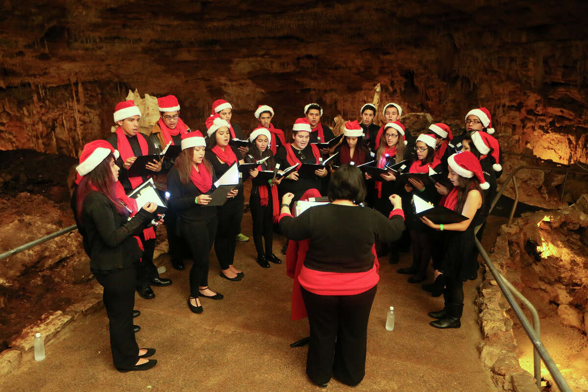 The Edison High School A Cappella Choir performs for a tour group in The Hall of the Mountain King during Christmas at the Caverns at Natural Bridge Caverns on Friday, Dec. 4, 2015. The holiday attraction features two underground Christmas shows: Caroling in the Caverns and Journey to Bethlehem, the AMAZEn' Reindeer Roundup, a Country Christmas Hayride, Canopy Challenge and