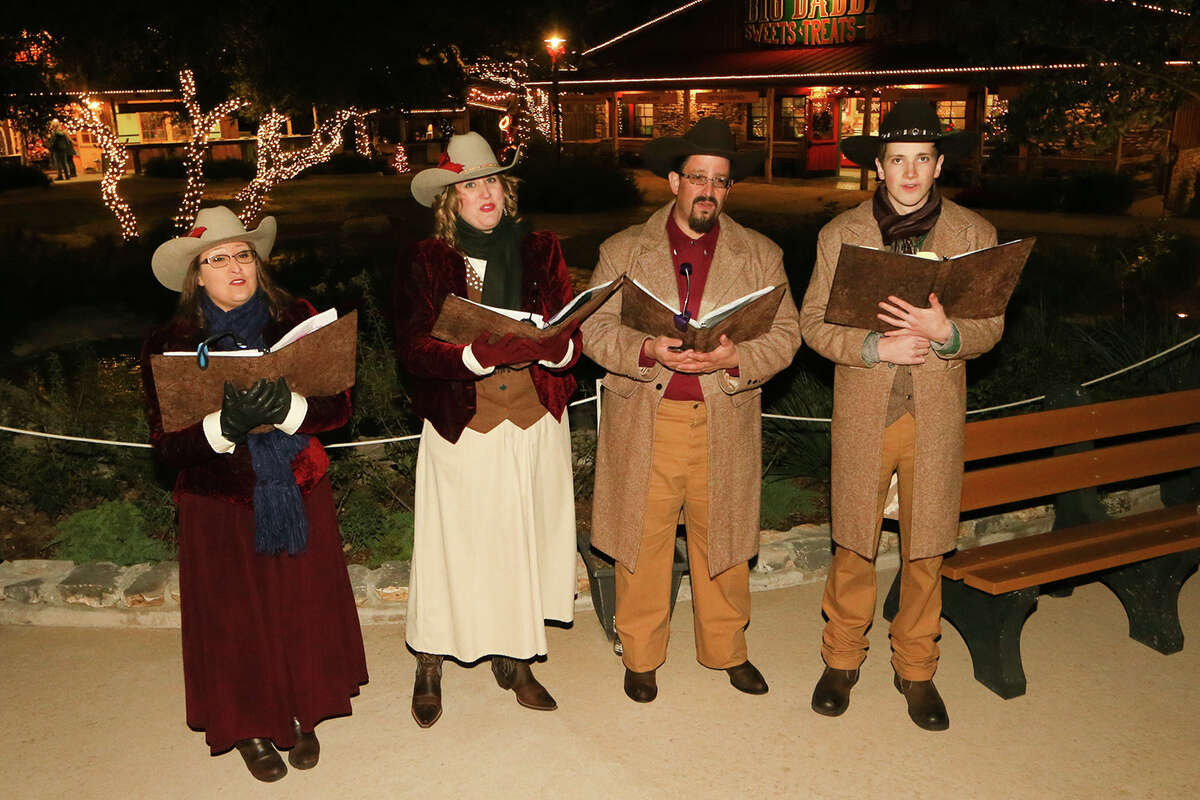 A choral quartet sings Chrismas Carols in the lighted Christmas Village during Christmas at the Caverns at Natural Bridge Caverns on Friday, Dec. 4, 2015. The holiday attraction features two underground Christmas shows: Caroling in the Caverns and Journey to Bethlehem, the AMAZEn' Reindeer Roundup, a Country Christmas Hayride, Canopy Challenge and