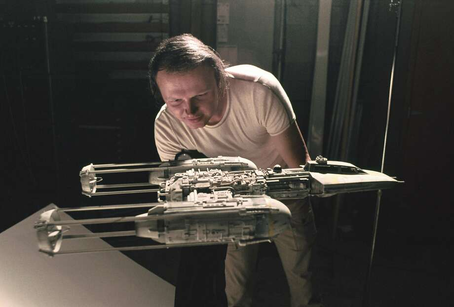 """Special effects artist Dennis Muren works on a model of a Y-wing fighter from """"Star Wars"""" early in his career at Industrial Light & Magic. As of 2015, Muren has worked at the company for 40 years. Photo: Courtesy ILM"""