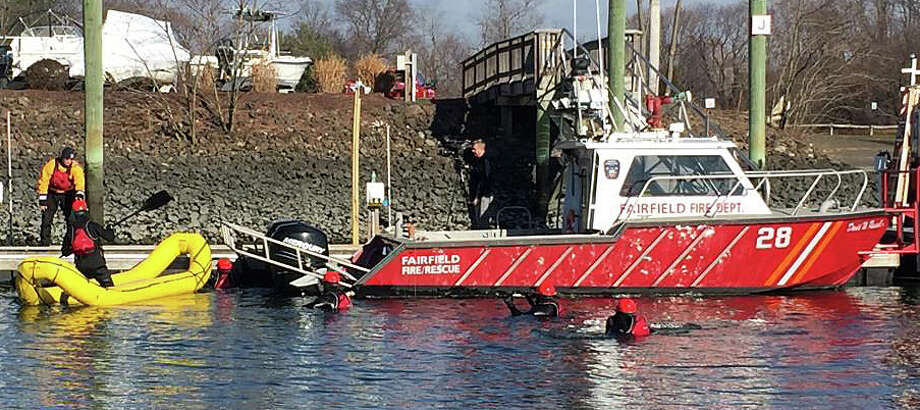 Firefighters hit the cold water off South Benson Marina for training in the water rescue technician program. Photo: Fairfield Fire Department / Fairfield Fire Department / Fairfield Citizen