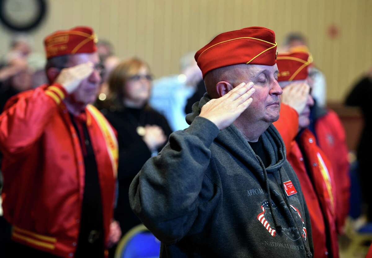 Former Albany County Executive Mike Hoblock, left, and J. J. Jennings, right, of the Marine Corps League salute during the playing of the National Anthem at a Pearl Harbor Memorial Observance at the Zaloga American Post Monday moring, Dec. 7, 2015, in Albany, N.Y. (Skip Dickstein/Times Union)