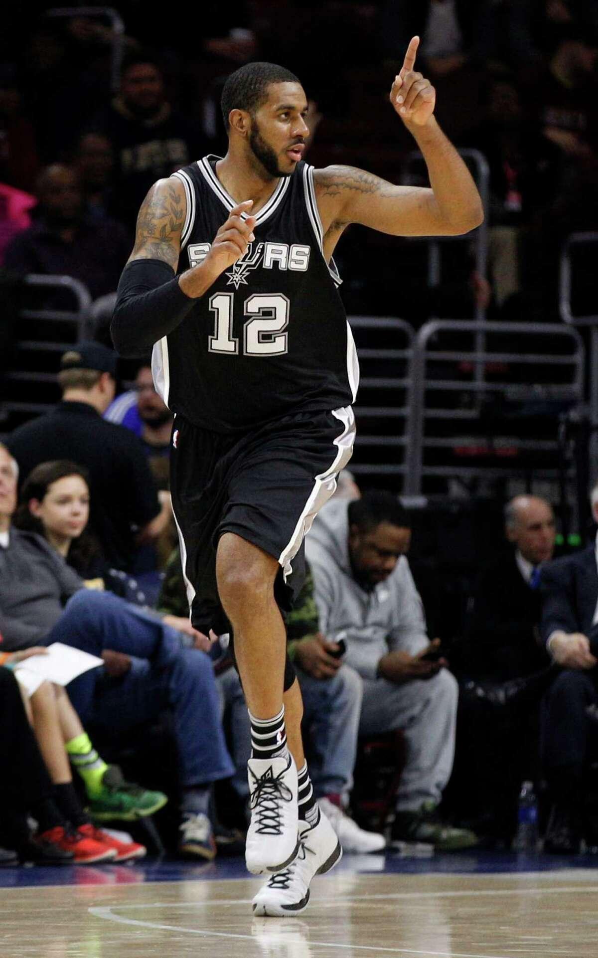 San Antonio Spurs' LaMarcus Aldridge reacts to his basket during the first half of an NBA basketball game against the Philadelphia 76ers, Monday, Dec. 7, 2015, in Philadelphia. (AP Photo/Chris Szagola)