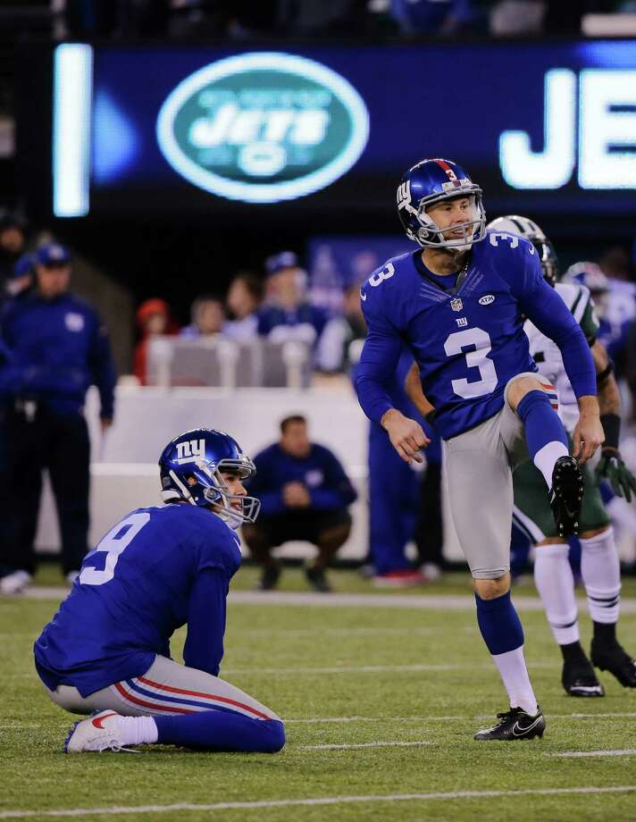 New York Giants kicker Josh Brown (3) and Brad Wing (9) react after Brown missed a field goal during overtime of an NFL football game against the New York Jets Sunday, Dec. 6, 2015, in East Rutherford, N.J. The Jets won 23-20. (AP Photo/Julie Jacobson) ORG XMIT: ERU129 Photo: Julie Jacobson / AP