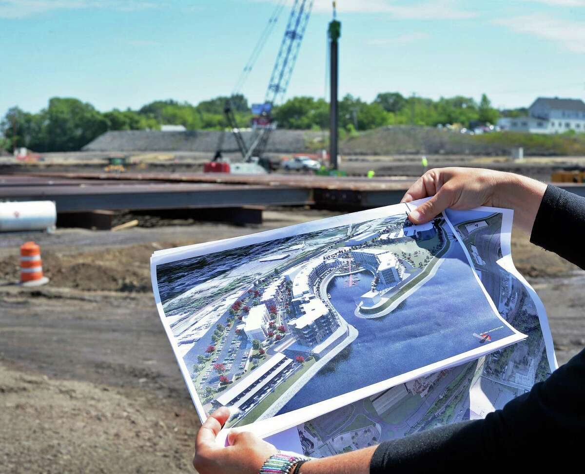 Crews drive in 55-foot steel harbor piles, top, constructing Mohawk Harbor, and an artists concept at the Rivers Casino site on Erie Blvd. Tuesday July 21, 2015, in Schenectady, N.Y. (John Carl D'Annibale / Times Union archive)