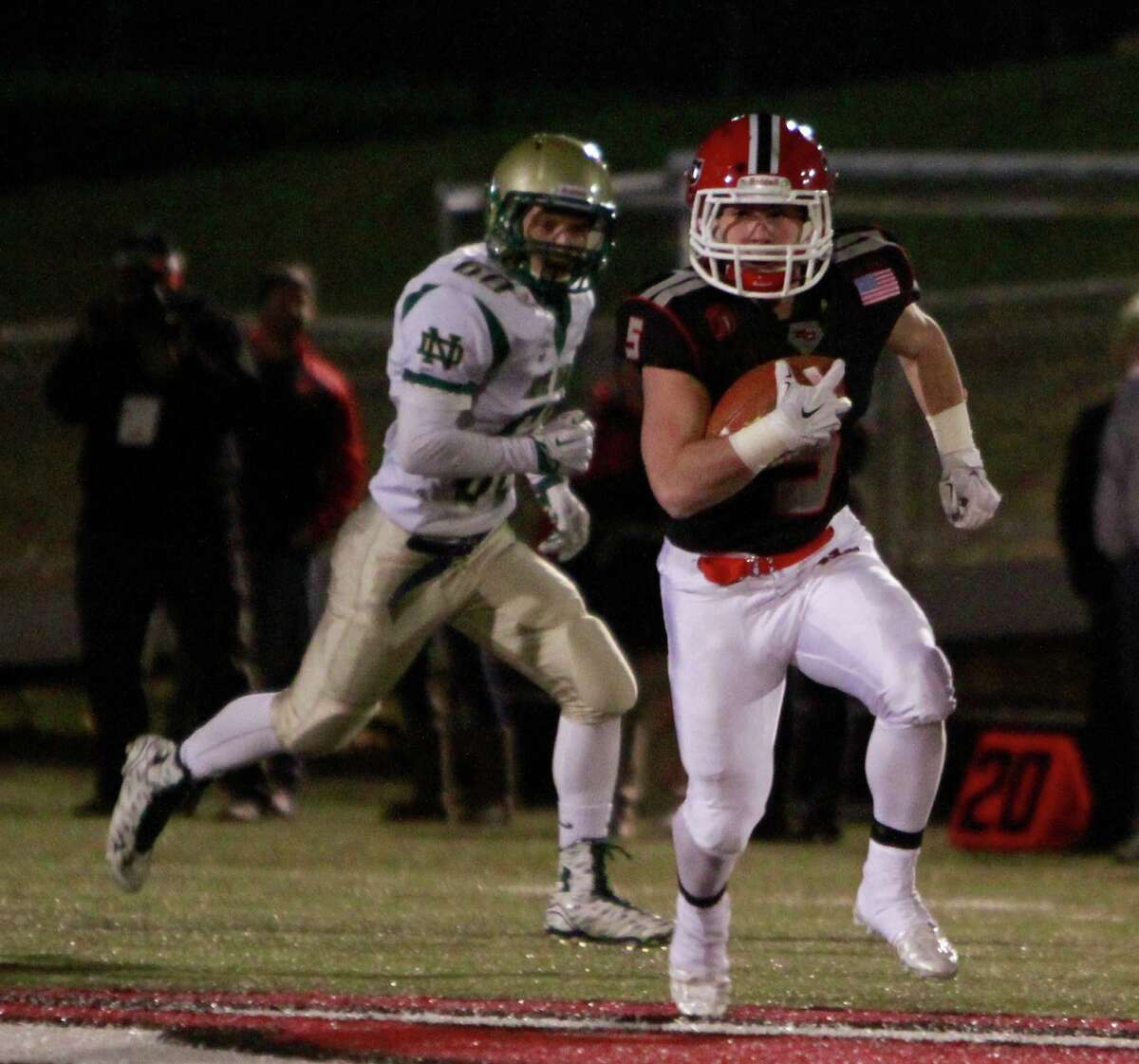 New Canaan's Matt Cognetta runs an 83 yard kickoff return for a touchdown against Notre Dame West Haven during the FCIAC Class L semi-final championship football game in New Canaan on Dec. 7, 2015. New Canaan won 51-27.