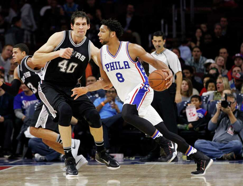 Philadelphia 76ers' Jahlil Okafor, right, drives to the basket against San Antonio Spurs' Boban Marjanovic, left, of Serbia during the second half of an NBA basketball game, Monday, Dec. 7, 2015, in Philadelphia. The San Antonio Spurs won 119-68. (AP Photo/Chris Szagola) Photo: Chris Szagola, Associated Press / FR170982 AP
