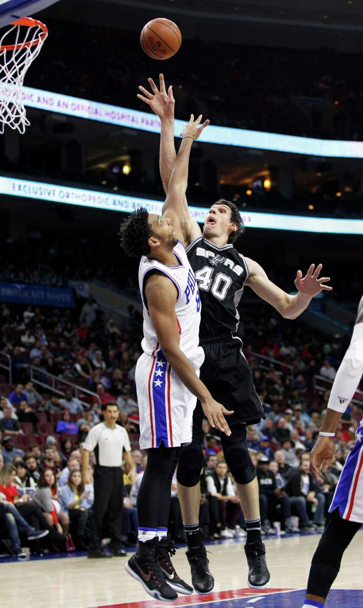 2795 x 4675~~$~~San Antonio Spurs' Boban Marjanovic, right, of Serbia puts up the shot over Philadelphia 76ers' Jahlil Okafor, left, during the second half of an NBA basketball game, Monday, Dec. 7, 2015, in Philadelphia.