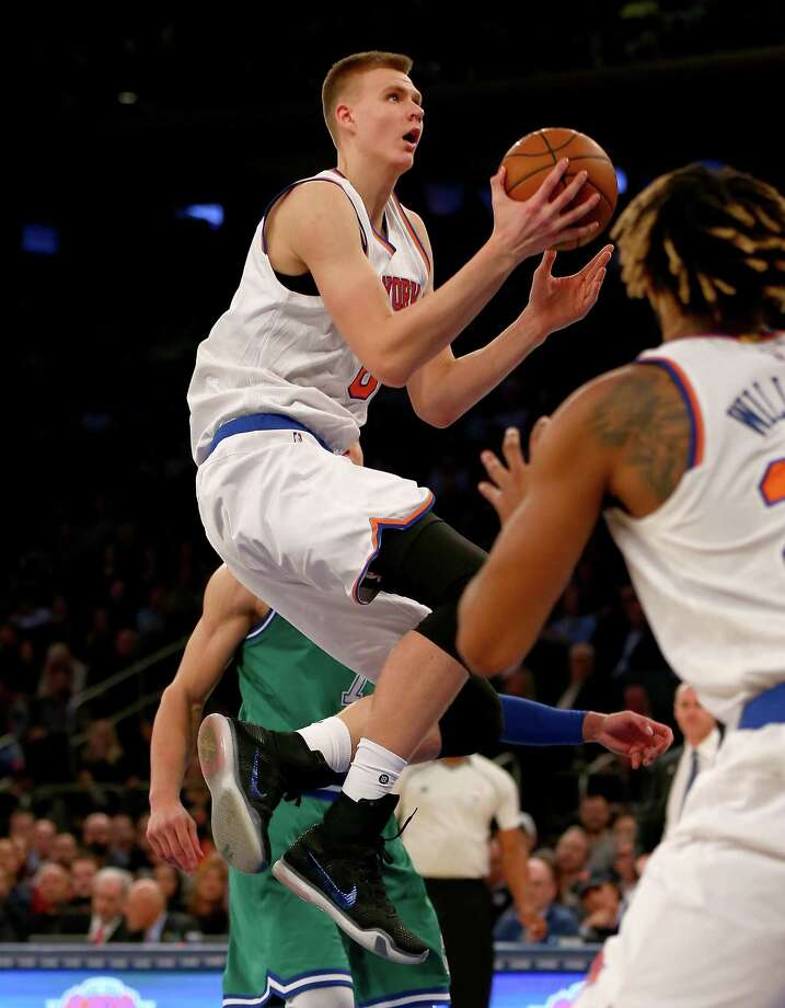 NEW YORK, NY - DECEMBER 07:  Kristaps Porzingis #6 of the New York Knicks heads for the net in the fourth quarter against the Dallas Mavericks at Madison Square Garden on December 7, 2015 in New York City.The Dallas Mavericks defeated the New York Knicks 104-97.  NOTE TO USER: User expressly acknowledges and agrees that, by downloading and/or using this Photograph, user is consenting to the terms and conditions of the Getty Images License Agreement.  (Photo by Elsa/Getty Images) ORG XMIT: 575727079 Photo: Elsa / 2015 Getty Images