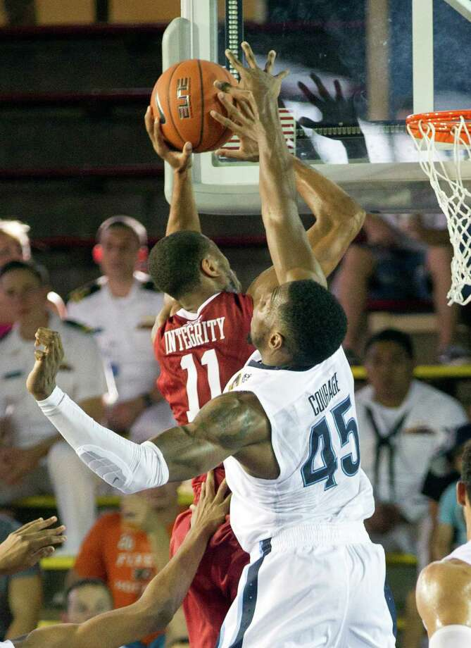 Oklahoma guard Isaiah Cousins (11) has his shot blocked by Villanova forward Darryl Reynolds (45) in the second half of an NCAA college basketball game at the Pearl Harbor Invitational on Monday, Dec. 7, 2015, in Honolulu. Oklahoma beat Villanova 78-55. (AP Photo/Eugene Tanner) ORG XMIT: HIET113 Photo: Eugene Tanner / FR168001 AP