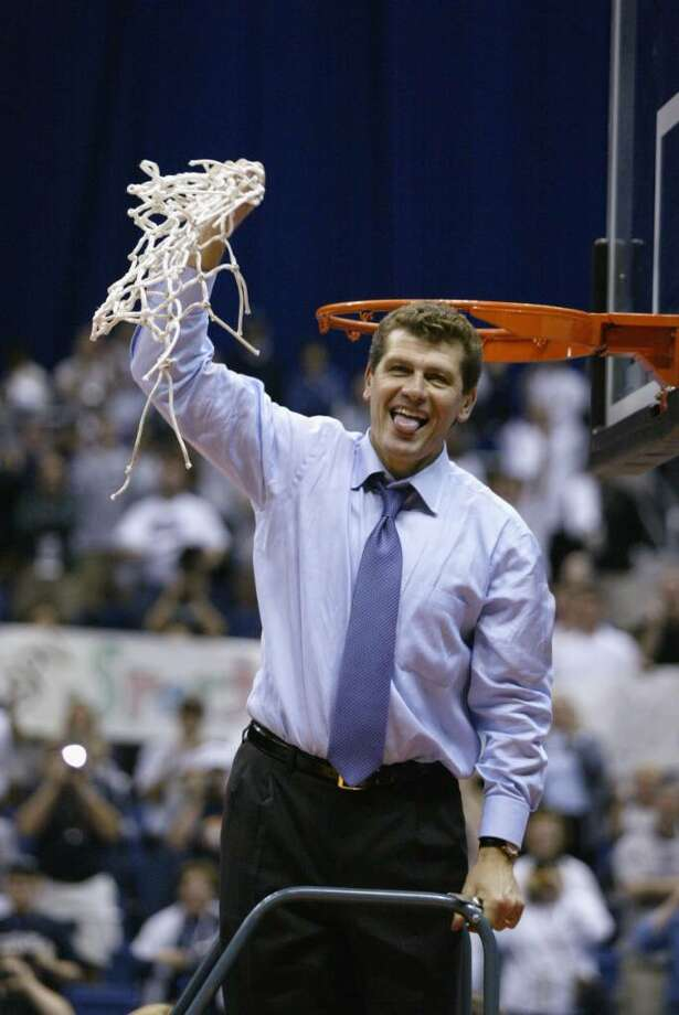 31 Mar 2002: Head coach Geno Auriemma of Connecticut waves the net after defeating Oklahoma 82-70 in the NCAA Women's Championship Game at the Alamo Dome in San Antonio,Texas. Connecticut finished their season undefeated. DIGITAL IMAGE. Mandatory Credit: Andy Lyons/Getty Images Photo: Andy Lyons, Getty Images / Getty Images