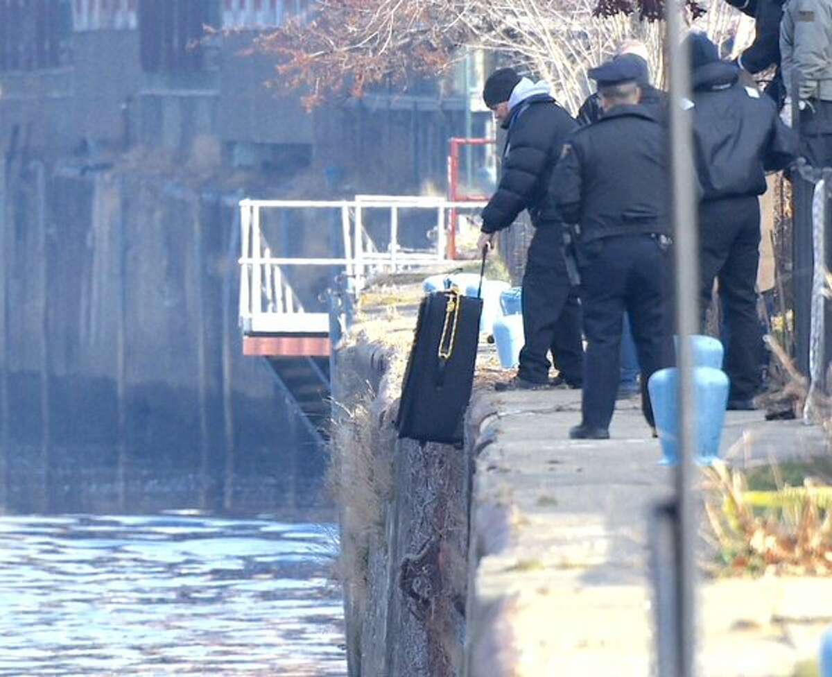 Police prepare to drop a bag into the Hudson River on Tuesday as they try to gauge how a suitcase holding a human body might travel if dropped into the river. The police are searching the river for traces of Noel Alkaramla, the 21-year-old city woman who vanished on Nov. 22. (Skip Dickstein / Times Union)