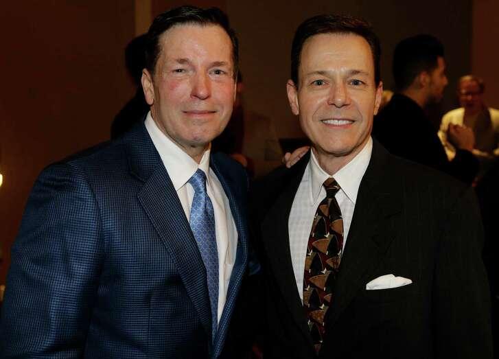 Scott Evans and Jeff Henry pose for a photo during event at the Hyatt Regency Houston, 1200 Louisiana,  Monday, Nov. 30, 2015, in Houston. ( Melissa Phillip  / Houston Chronicle )