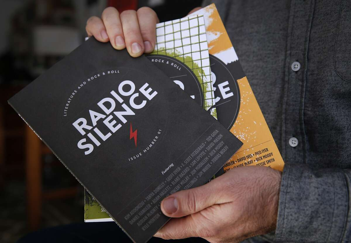 Dan Stone holds the three editions of his publication in Oakland, Calif. on Friday, Dec. 4, 2015. Stone is the founder and editor of Radio Silence, a print and digital publication featuring essays, poetry and other stories with an emphasis on music.