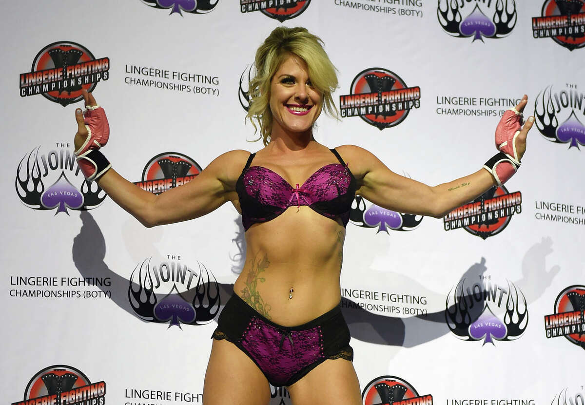 """LAS VEGAS, NV - AUGUST 08: Fighter Teri """"Feisty Fists"""" London is introduced during """"Lingerie Fighting Championships 20: A Midsummer Night's Dream"""" at The Joint inside the Hard Rock Hotel & Casino on August 8, 2015 in Las Vegas, Nevada."""