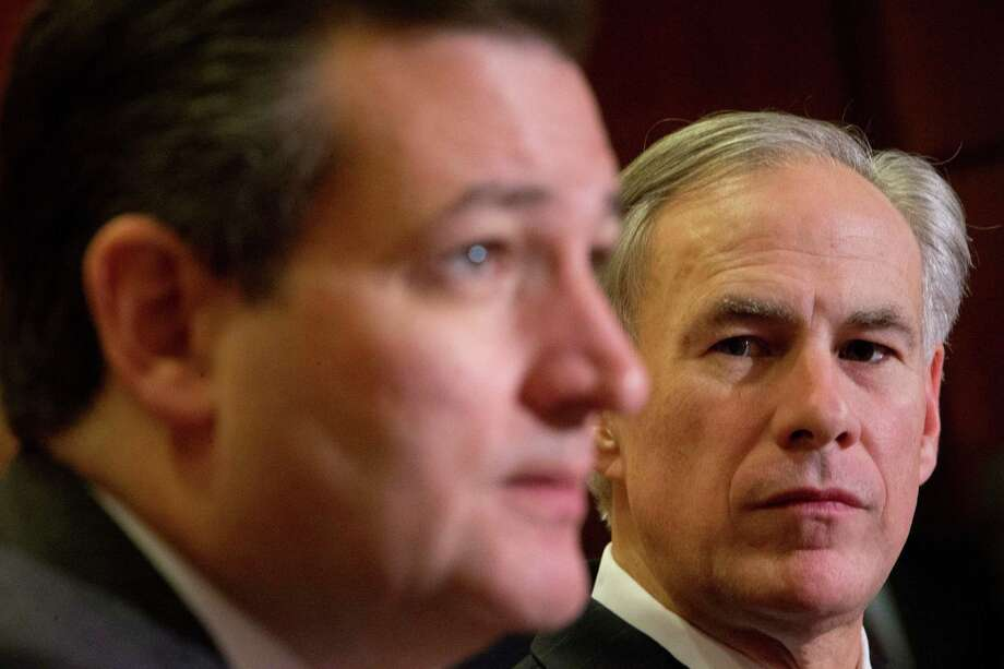 Texas Gov. Greg Abbott (right) listens to Republican presidential candidate Sen. Ted Cruz, R-Texas,  speak about the resettlement of Syrian refugees in the U.S., during their joint news conference on Capitol Hill on Tuesday. Photo: Pablo Martinez Monsivais /Associated Press / AP