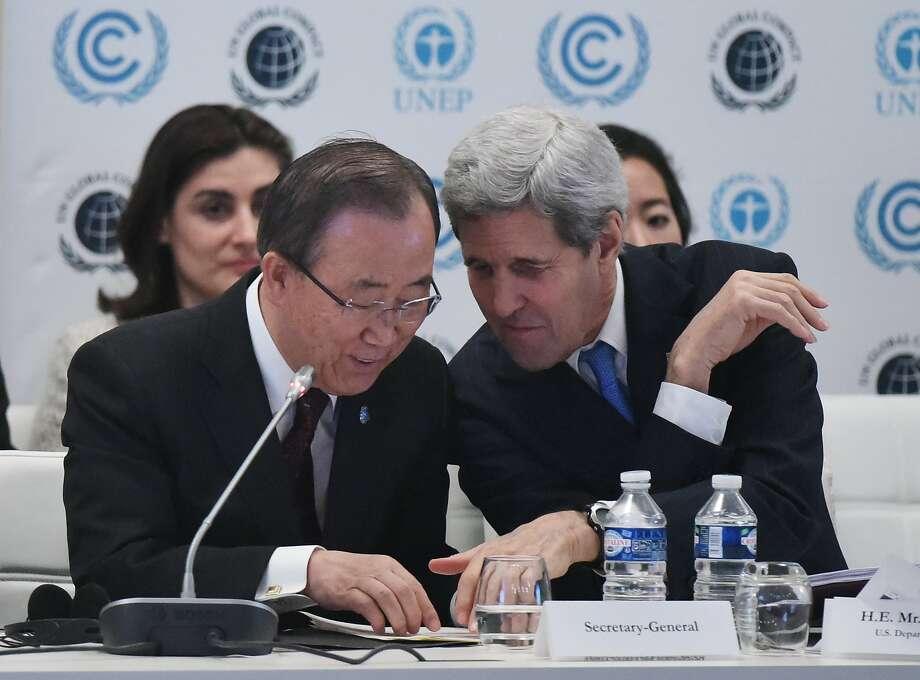 Secretary of State John Kerry talks with UN Secretary General Ban Ki-moon. Photo: Mandel Ngan, Associated Press