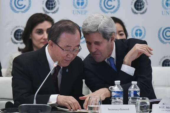 US Secretary of State John Kerry, right, talks with United Nations Secretary General Ban Ki-moon during the Caring for Climate Business Forum event as part of the COP 21 United Nations conference on climate change, Tuesday Dec. 8, 2015 in Le Bourget, on the outskirts of Paris. The Paris conference is the 21st time world governments have met to seek a joint solution to climate change — and is aiming at the most ambitious, long-lasting accord yet. (Mandel Ngan/Pool Photo via AP)