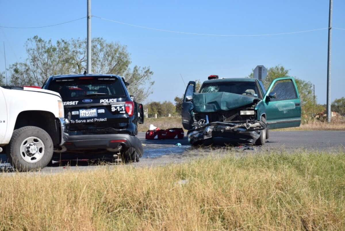 Emergency responders work the scene of a multi-vehicle crash near Benton City Road and Loop 1604 in Southwest Bexar County on Dec. 8, 2015. A Somerset police officer was involved in the accident.