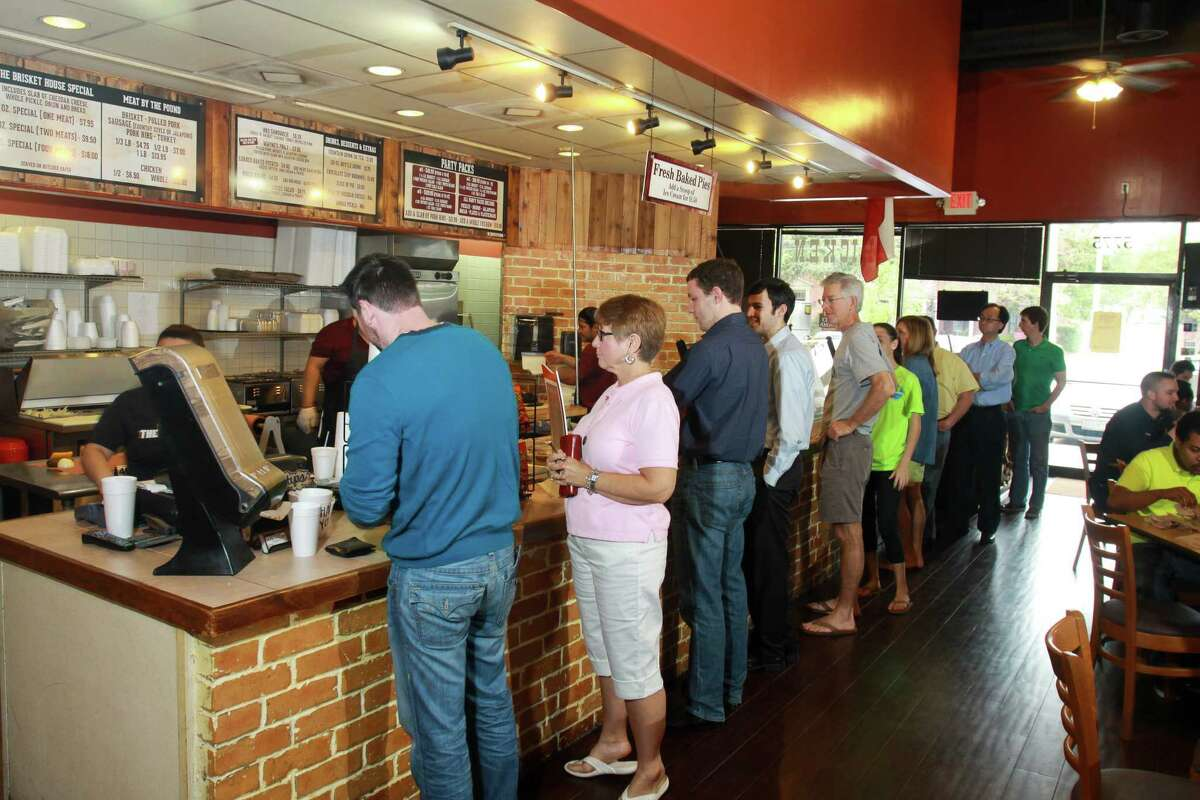 (For the Chronicle/Gary Fountain, March 28, 2014) Customers lined up to put in orders at the Brisket House in west Houston.