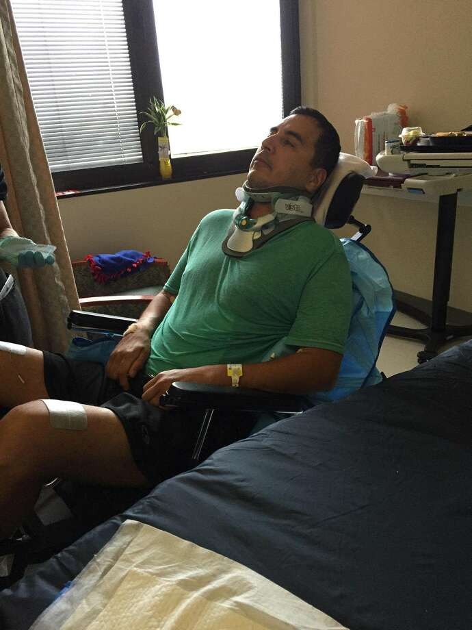 Roger Carlos, who was beaten by San Antonio police by mistake,  sits in his room at Memorial Hermann Medical Center in Houston on Tuesday, Dec. 8. Photo: Courtesy
