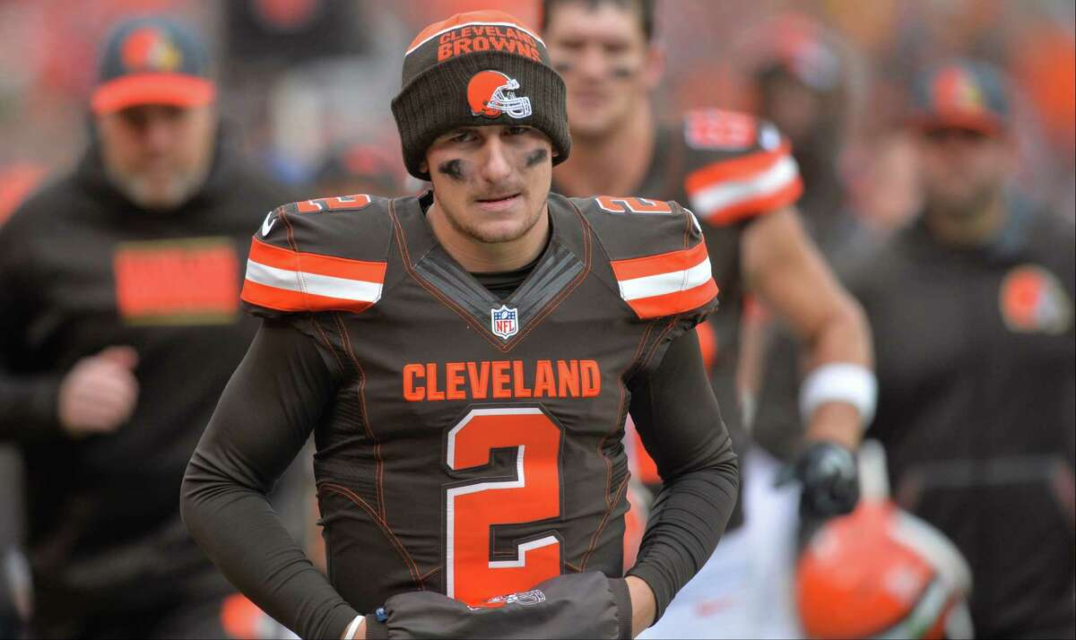 Browns quarterback Johnny Manziel walks off the field at halftime against the Cincinnati Bengals on Dec. 6, 2015, in Cleveland.