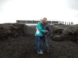 "Tuesday Simmons and her husband, Brian, of Albany, standing in front of the ""bridge between continents"" in Iceland."