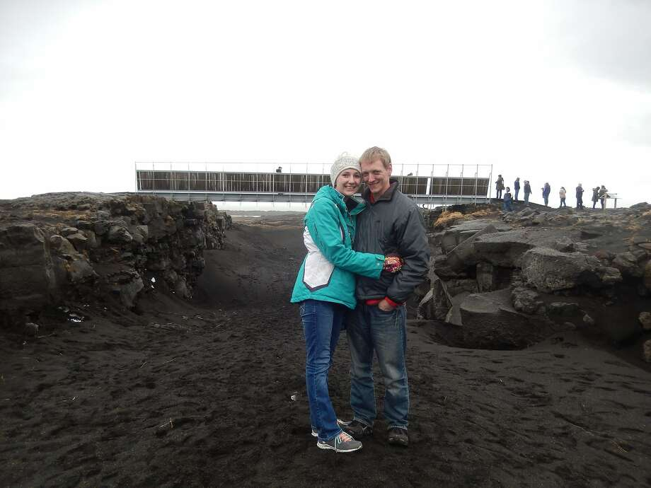 "Tuesday Simmons and her husband, Brian, of Albany, standing in front of the ""bridge between continents"" in Iceland. Photo: Courtesy Of Tuesday Simmons"