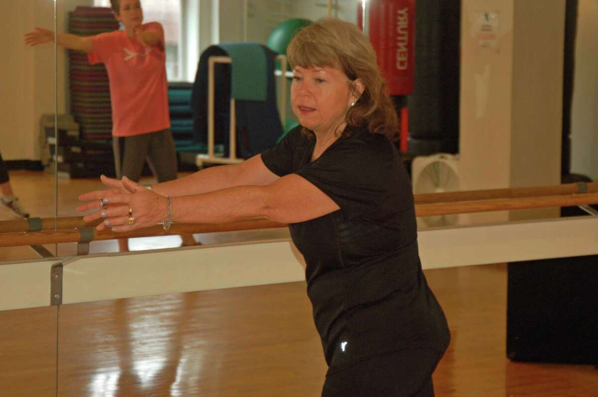 Wendy Lee Rosa (right) goes through a routine copied by Ashley Luneburg at a class at the YMCA. Rosa is creating an exercise class to offer support and exercise to women who are undergoing treatment for or recovering from breast cancer. There is a link between cancer prevention and survival and exercise, and a new Yale study has a possible explanation why.