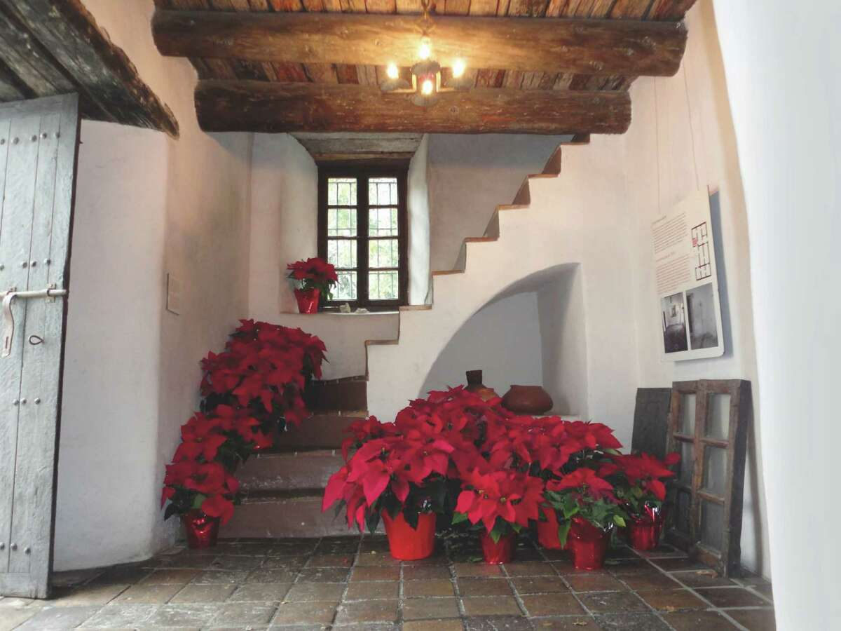The Spanish Governor's Palace in San Antonio is decorated for the holidays in a simple, spare style - just a few red poinsettias are scattered through its rooms.