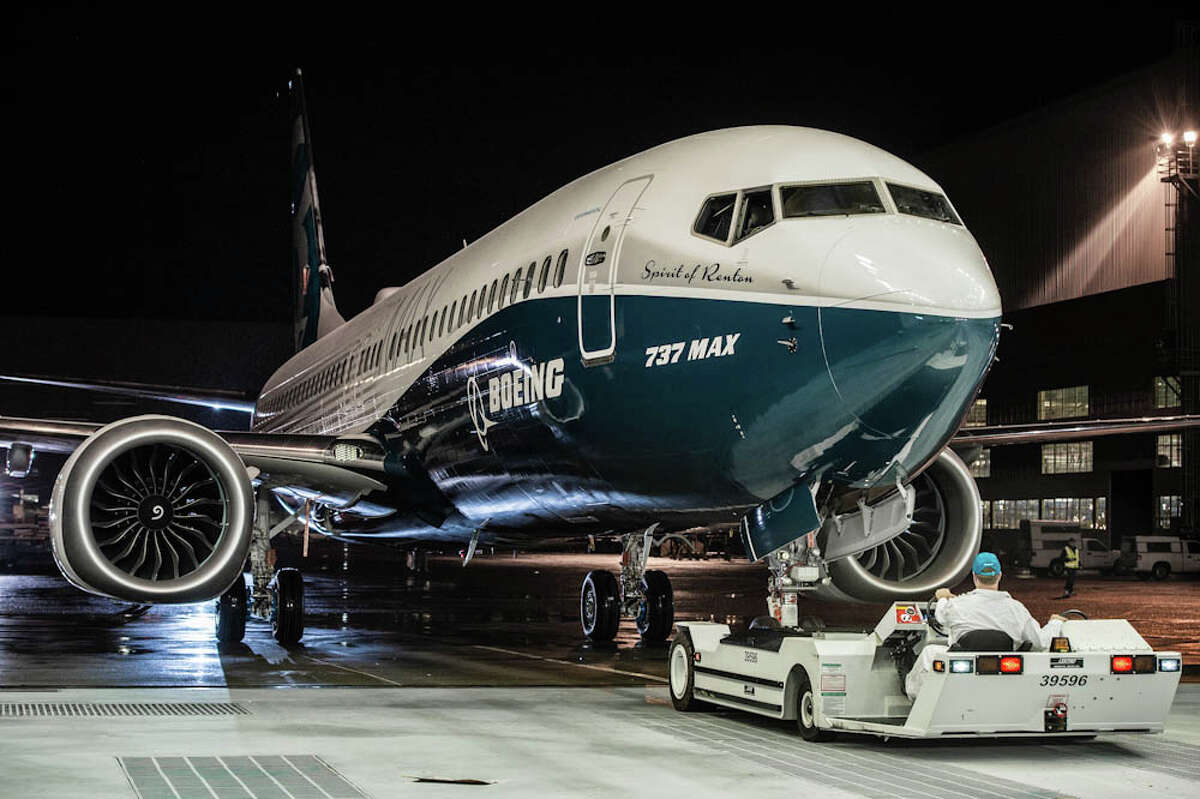 """Boeing on Tuesday debuted its new 737 MAX 8 airplane for employees at the Renton factory. This view shows the teal paint scheme Boeing chose for the plane, which it has named the """"Spirit of Renton."""" Photo courtesy Boeing."""