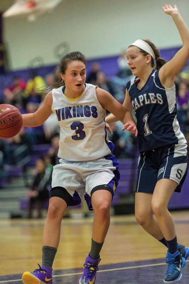 Westhill High School's Edona Thaqi drives toward the basket as Staples High School's Rachel Seideman tries to stop her during a girls basketball game against  played at Westhill High School Stamford, CT on Friday, December 12th, 2014 Photo: Mark Conrad / Mark Conrad / Connecticut Post Freelance