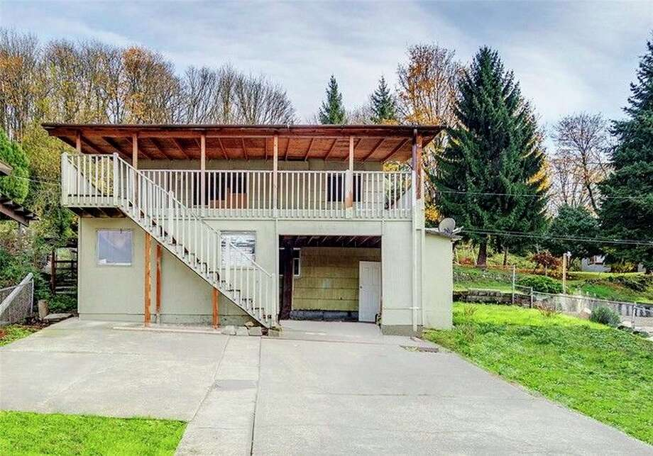 The first home, 6020 19th Ave. S., is listed for $370,000. Although it is on the other side of the freeway in Beacon Hill, it's still close to the Georgetown area. The finished basement has a kitchen that could make a great rental unit.  You can see the full listing here. Photo: Arnold Grant, Cristina Zalavarria, Windermere Real Estate North / Arnold Grant