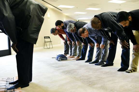 Muslim men pray during Dhuhr, or noon prayer, at the San Ramon Valley Islamic Center in San Ramon, CA Tuesday, December 8, 2015.