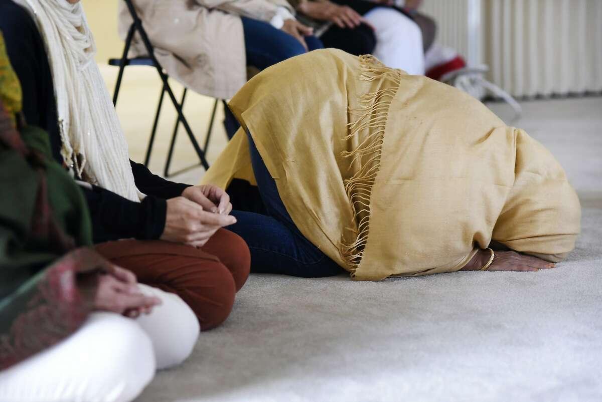 Muslim women pray during Dhuhr, or noon prayer, at the San Ramon Valley Islamic Center in San Ramon, CA Tuesday, December 8, 2015.