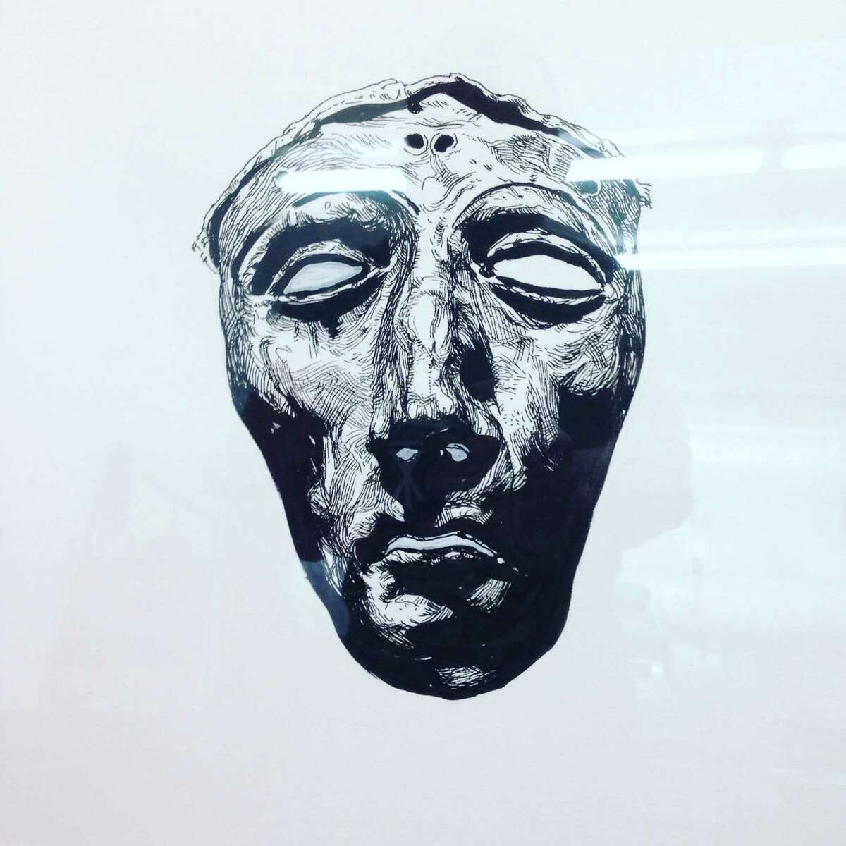 This ink drawing by Vincent Valdez of a Grecian death mask was taken off a wall of Bakery Lorraine at the Pearl.