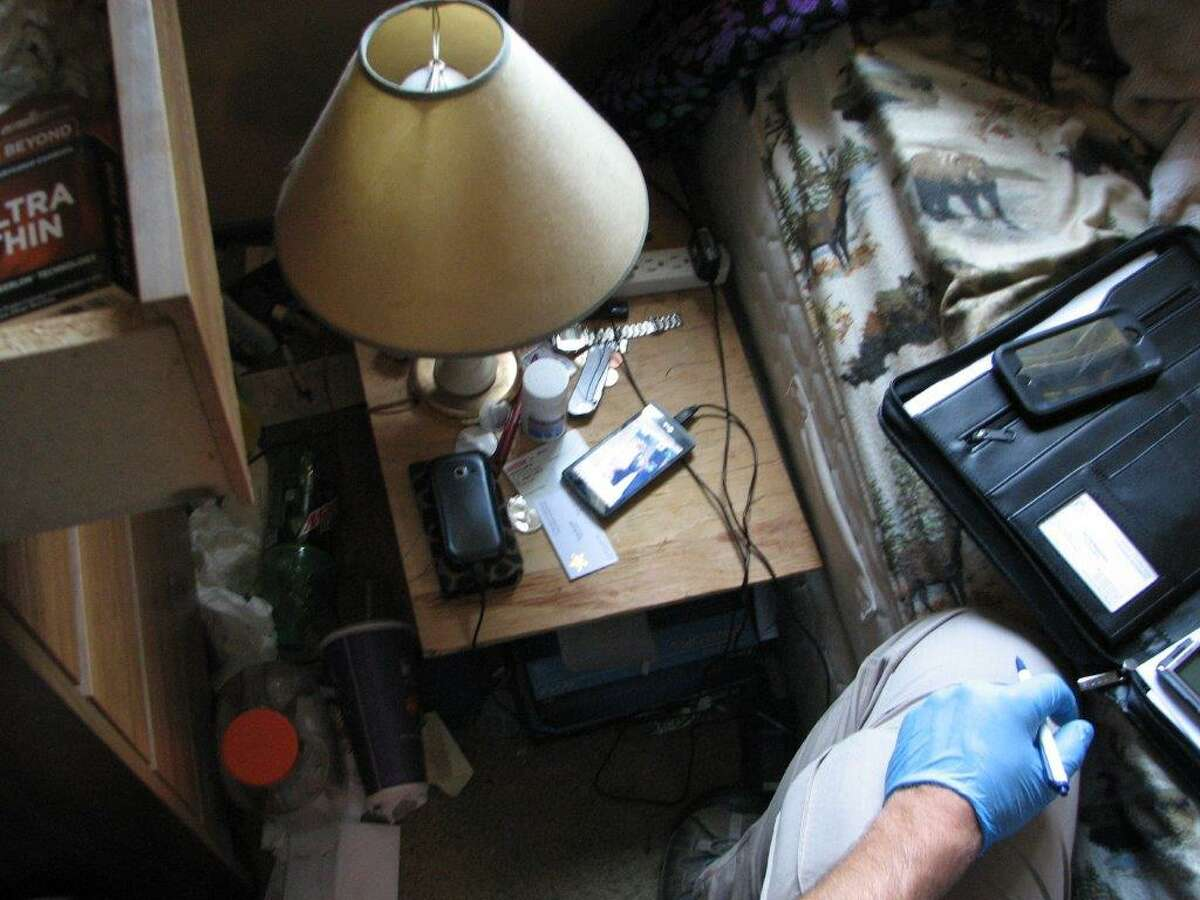 Investigators examine the Washington home of a child pornography suspect during a recent search.