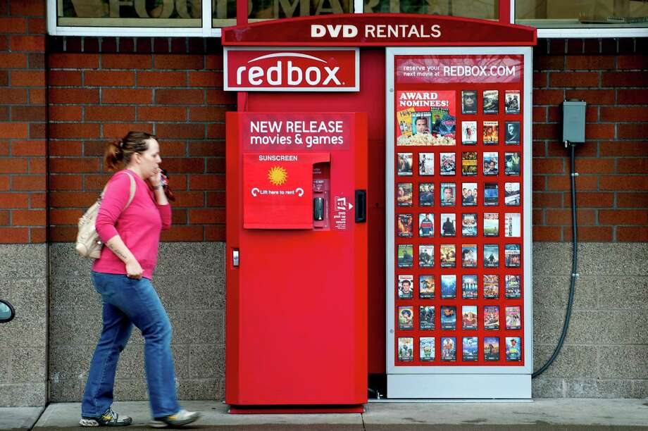 A Coinstar Redbox movie rental kiosk in the Ballard neighborhood of Seattle, Feb. 10, 2012. Coinstar, the self-service retail business, is preparing for the decline of movie rentals by experimenting with kiosks for products like coffee and electronics. (Stuart Isett/The New York Times) Photo: STUART ISETT / ©2012 Stuart Isett. All rights reserved.
