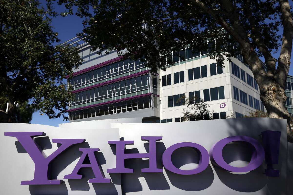 This Wednesday, Oct. 17, 2012, file photo, shows a sign in front of Yahoo headquarters in Sunnyvale, Calif. In discussions that began Wednesday, Dec. 2, 2015, Yahoo's board is mulling an activist shareholder's demand to sell the Internet services that define the company to avoid paying more than $10 billion in taxes on its gains from a lucrative investment in China's Alibaba Group.