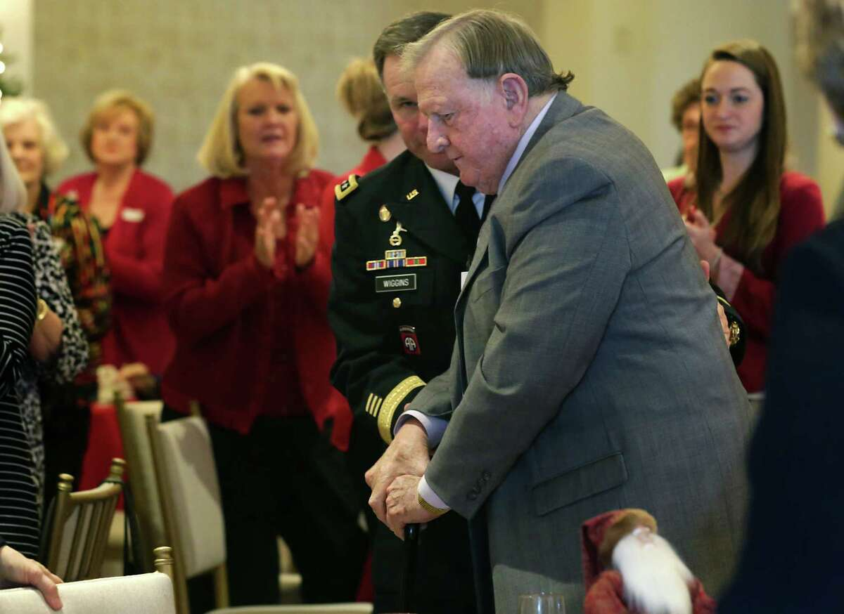 Red McCombs, who sits on the board of the nonprofit Alamo Endowment, is assisted by Lieutenant General Perry Wiggins Commander United States Army North, to address members of the Daughters of the Republic of Texas Alamo Mission Chapter on Tuesday, Dec. 8, 2015. McCombs spoke about the future of the Alamo, at the group's annual luncheon held at the San Antonio Country Club.