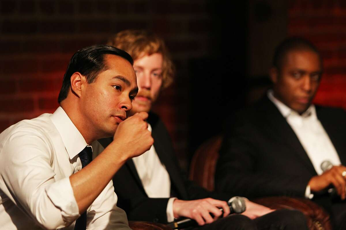 From left, US Federal Secretary of Housing and Urban Development Julian Castro, CEO of GitHub, Chris Wanstrath and Chief Program Officer of Everyone On, Chike Aguh, speaking at GitHub in San Francisco on December 8, 2015