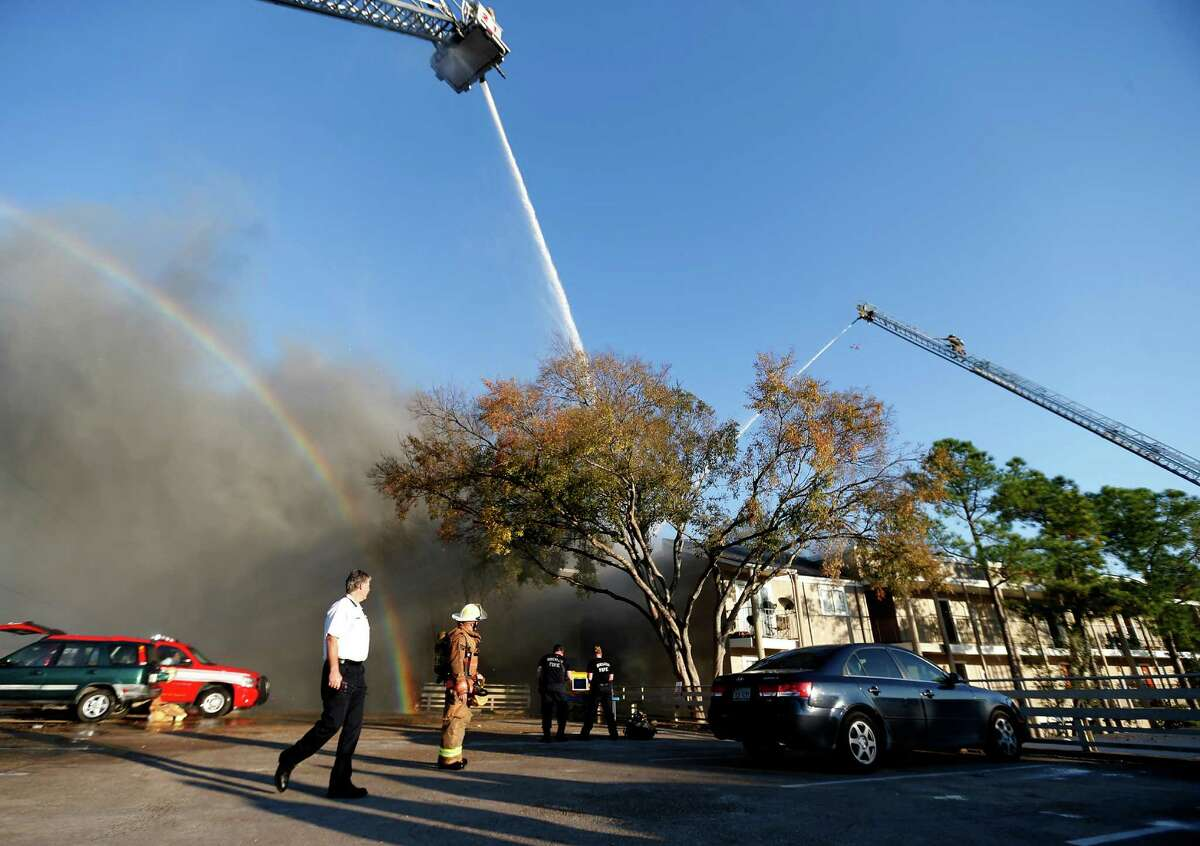 Houston firefighters battle a four-alarm blaze in the 6400 block of Westheimer on Tuesday.