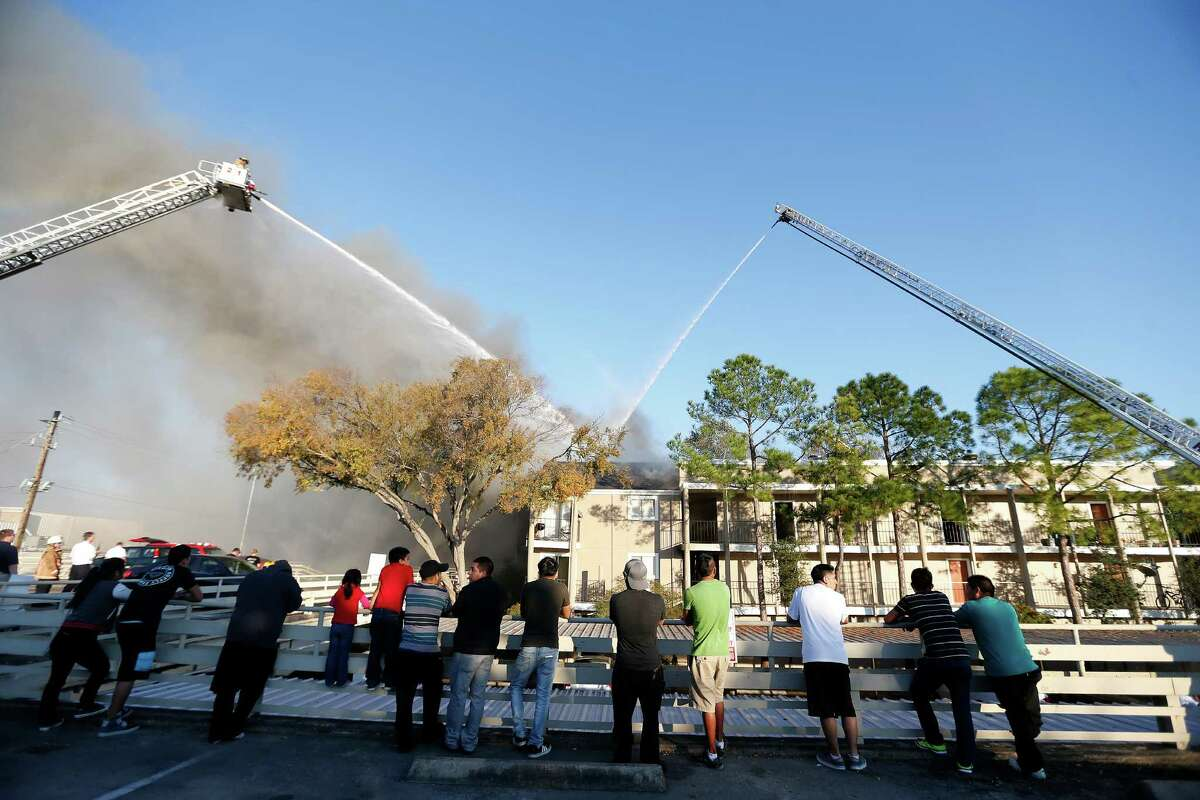 Firefighters battle a four-alarm blaze in the 6400 block of Westheimer on Tuesday.