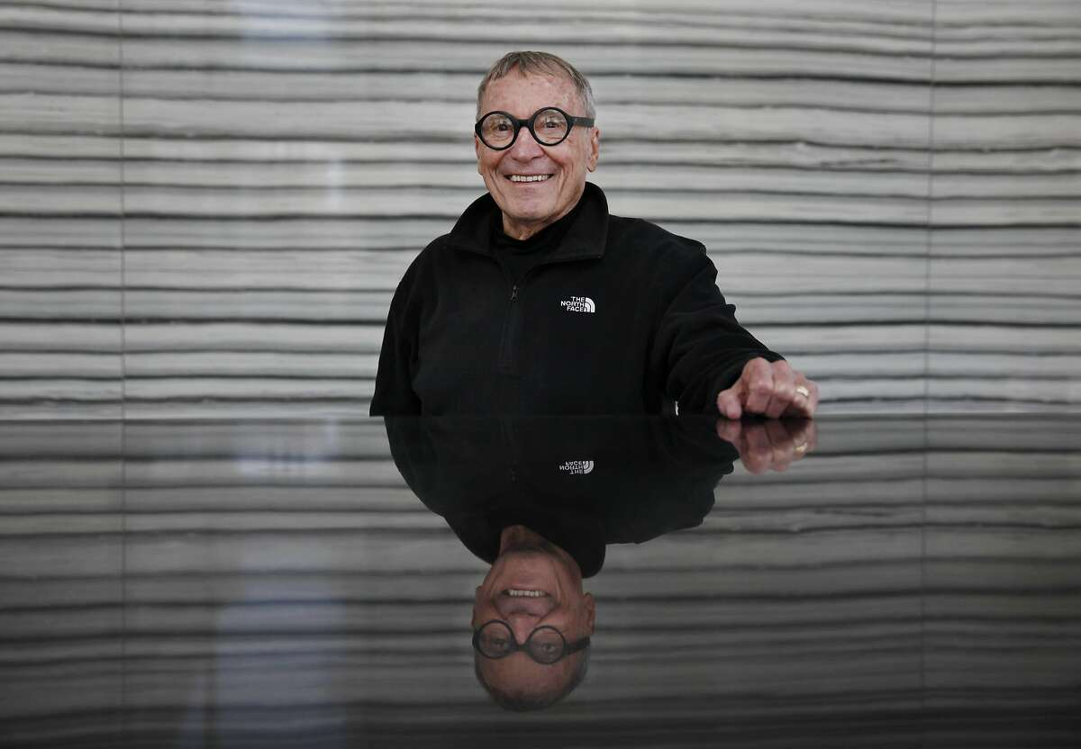 Angelo Sangiacomo is reflected in the granite front desk of the tower built in phase two of the Trinity Place project on Wednesday, April 11, 2013 in San Francisco, Calif.