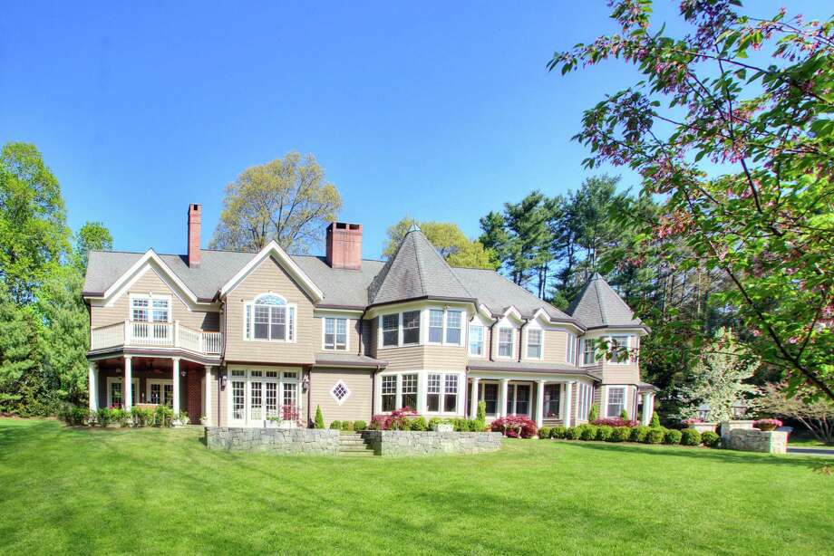This five-bedroom Colonial in Tokeneke has six fireplaces and two wine cellars. Photo: Contributed / Contributed Photo / Darien News